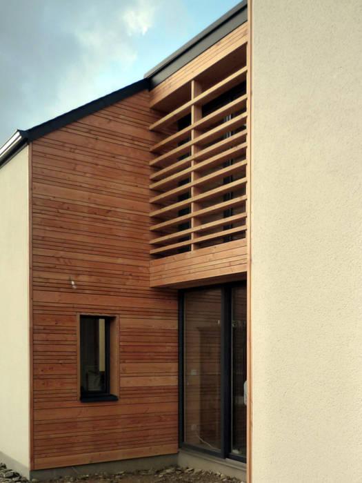 projet maison ossature bois: Terrasse de style  par yg-architecte