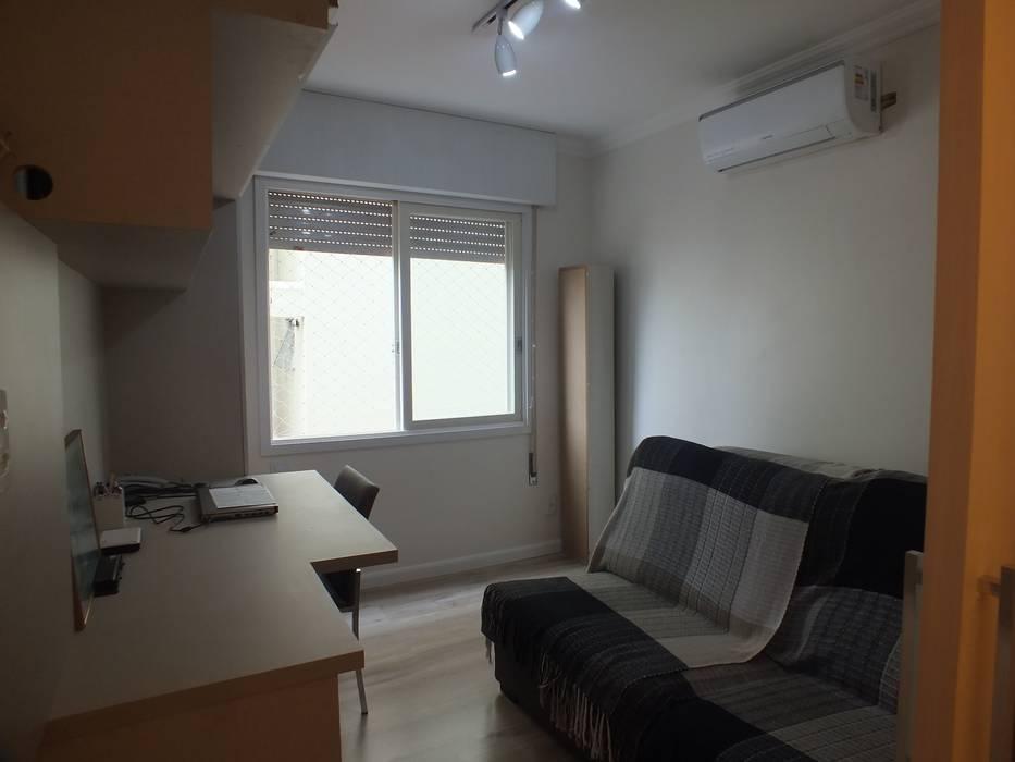 Quarto de hospedes/home office: Quartos  por Arketing Identidade e Ambiente,Clássico