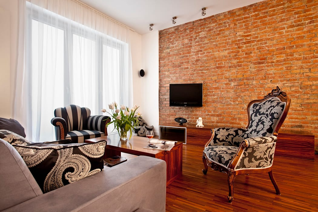 Salon ze stylizowanymi meblami Eklektyczny salon od living box Eklektyczny
