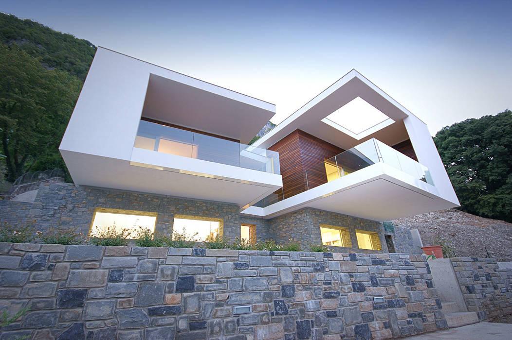 Houses by STUDIO ARCHITETTURA MASSIMO NODARI