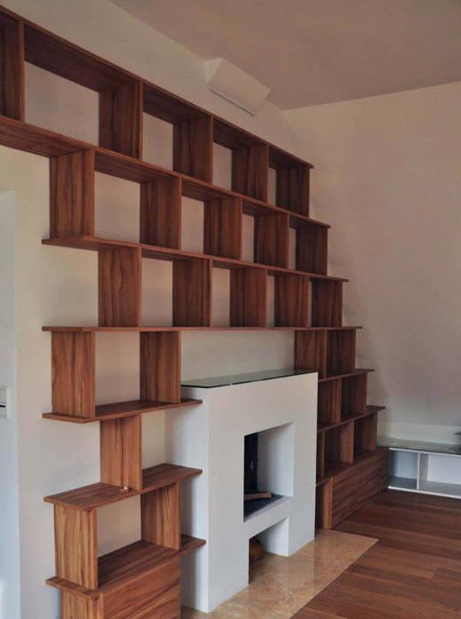 adaptation sur mesure: Bureau de style de style Moderne par officine TNT Architecture