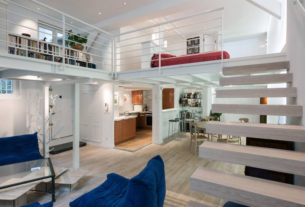 Living room by Fables de murs, Modern