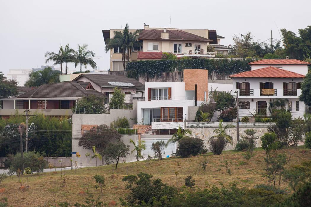 Residência Parque dos Príncipes: Casas  por Nautilo Arquitetura & Gerenciamento