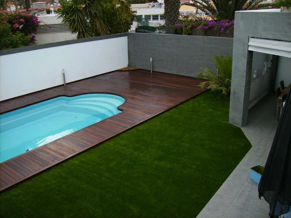 Instalación Césped Artificial Playa del Inglés: Jardines de estilo  de Ceramistas s.a.u., Rural