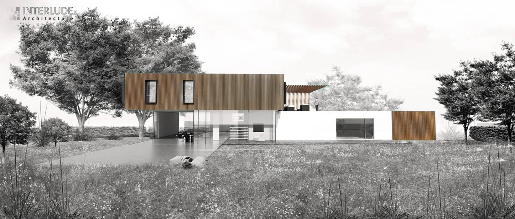 Vue Façade Sud Ouest: Maisons de style  par Interlude Architecture