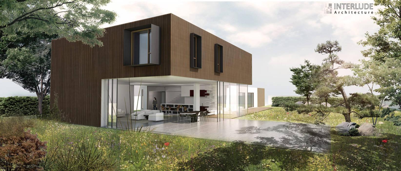 Vue sur la terrasse: Maisons de style  par Interlude Architecture