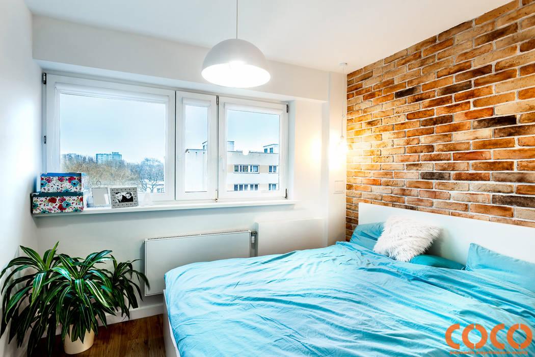 Dormitorios modernos de COCO Pracownia projektowania wnętrz Moderno