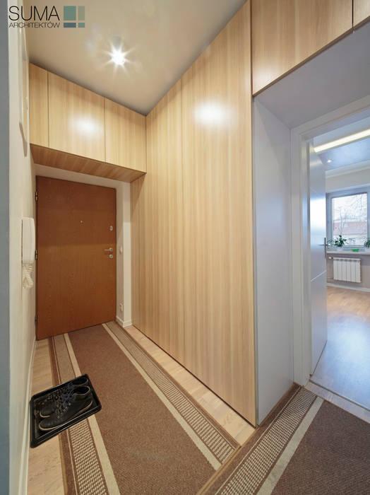 FAMILY_ONE Nowoczesny korytarz, przedpokój i schody od SUMA Architektów Nowoczesny