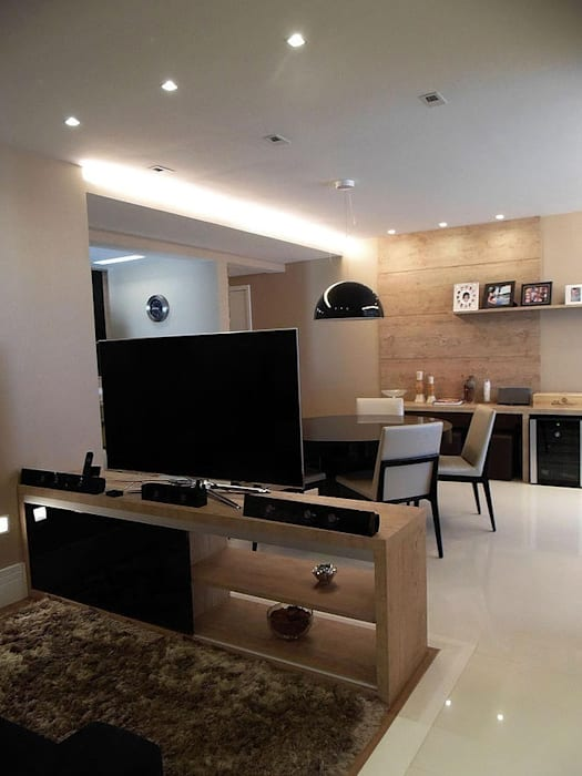 Home Cinema + Sala de Jantar: Salas multimídia  por Paula Werneck Arquitetura,