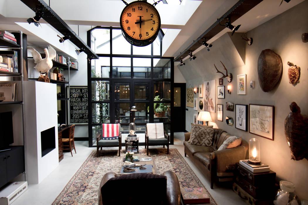 Industriele Loft Woonkamer : Garage loft: woonkamer door bricks studio homify