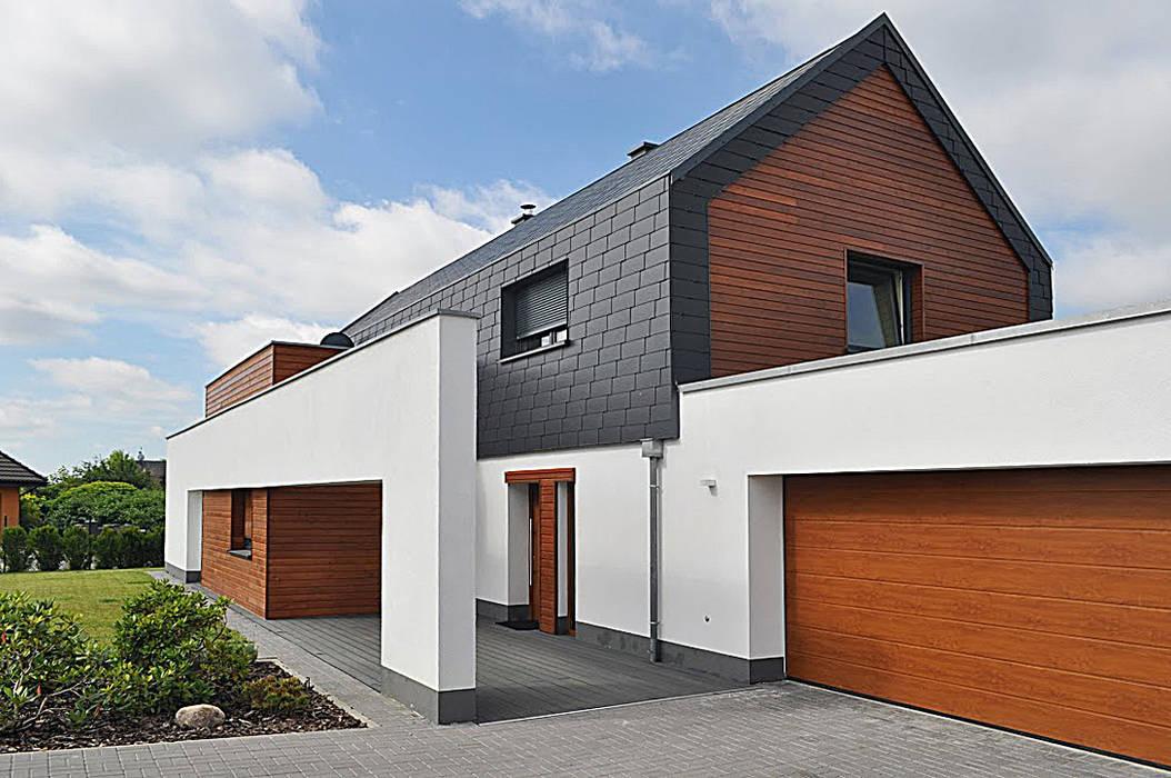 Houses by STRUKTURA Łukasz Lewandowski, Modern