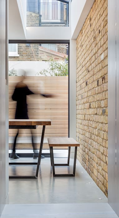 sliding glass:  Dining room by Thomas & Spiers Architects,