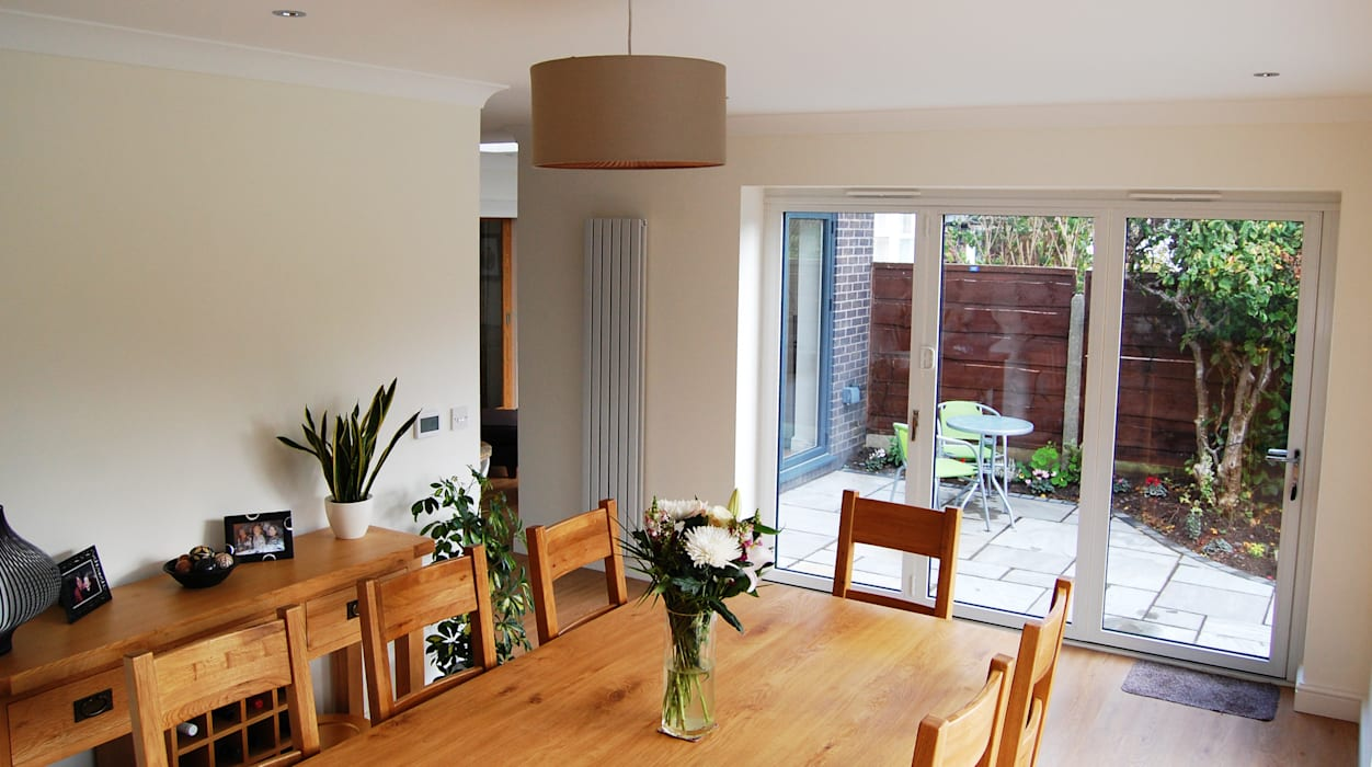 Extension to rear, Sun Room, Kitchen and Living Room Grant Erskine Architects Modern dining room
