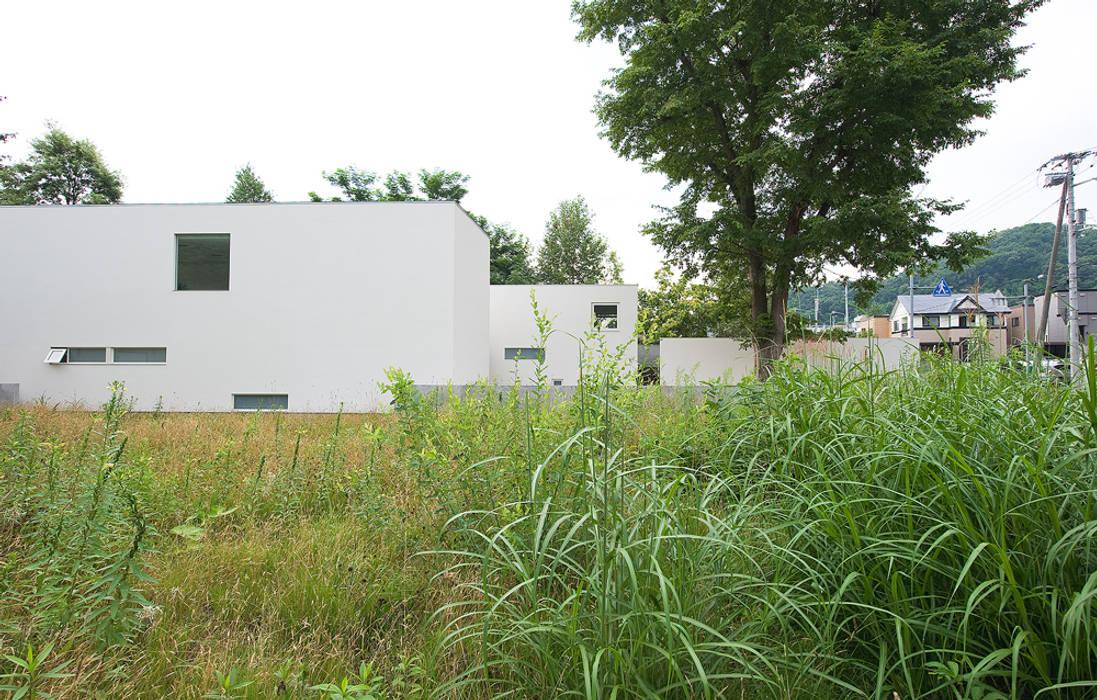 Casas estilo moderno: ideas, arquitectura e imágenes de 株式会社コウド一級建築士事務所 Moderno