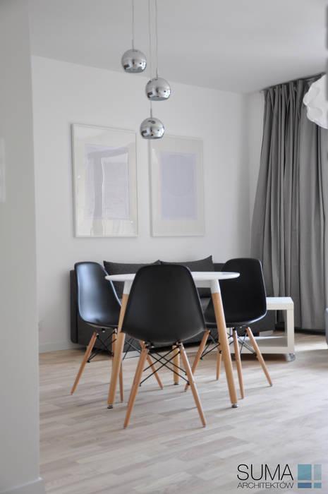M33_RENT_ONE Nowoczesny salon od SUMA Architektów Nowoczesny
