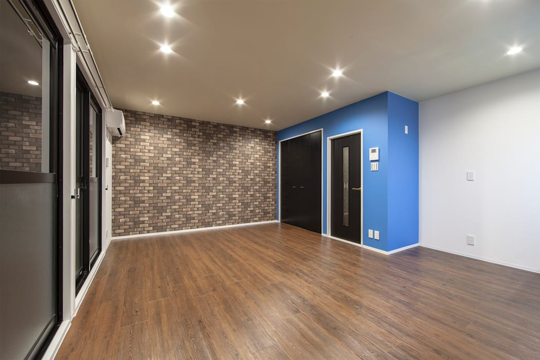 NEW YORKER LIFE: 株式会社クラスコデザインスタジオが手掛けたリビングです。