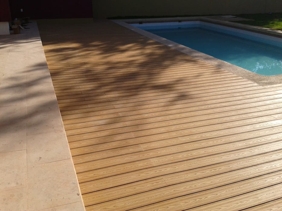 Tropical style pool by Grupo Boes Tropical