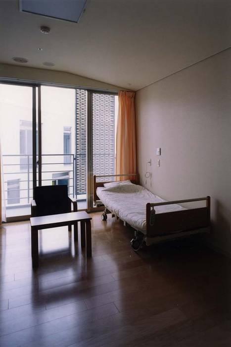 個室 モダンスタイルの寝室 の 株式会社ヨシダデザインワークショップ モダン