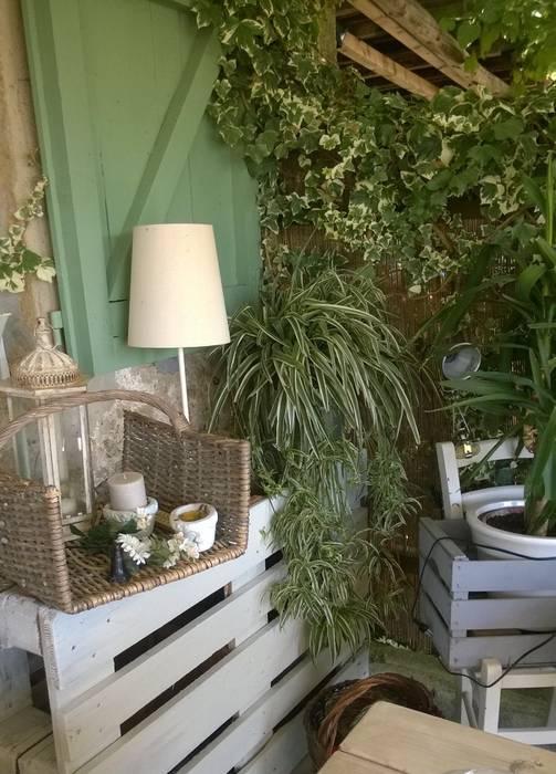 Armonia: Giardino d'inverno in stile in stile Mediterraneo di VIVERE IL FUORI