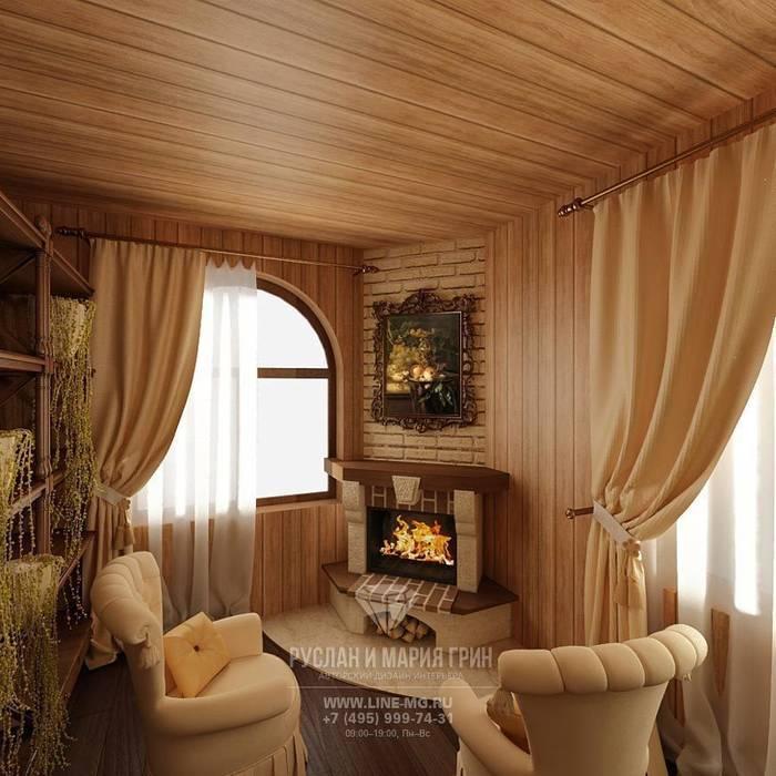 Интерьер гостиной с камином в дизайне дома из бруса: Гостиная в . Автор – Студия дизайна интерьера Руслана и Марии Грин, Классический