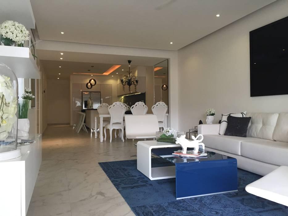 SALA: Salas de estilo  por DECO Designers,