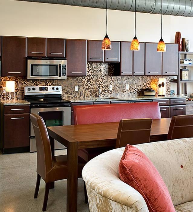 Modern dining room by Deeco Modern