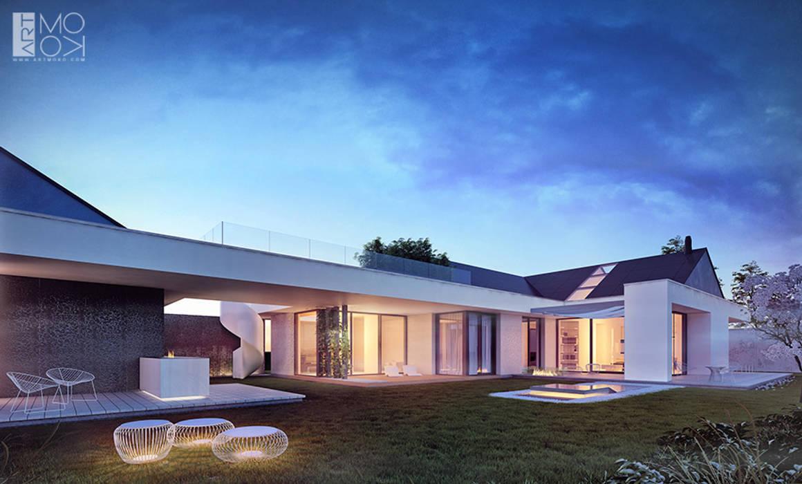 Dom parterowy z licznymi tarasami: styl , w kategorii Domy zaprojektowany przez Pracownia projektowa artMOKO