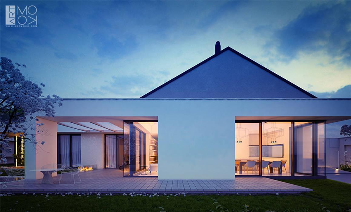 Dom parterowy z licznymi przeszkleniami: styl , w kategorii Domy zaprojektowany przez Pracownia projektowa artMOKO