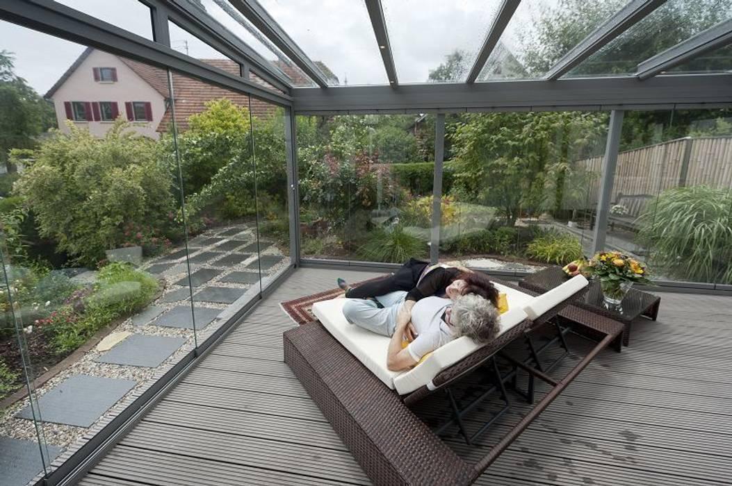 Terrassendach aus Glas:  Terrasse von MR Gruppe,Modern