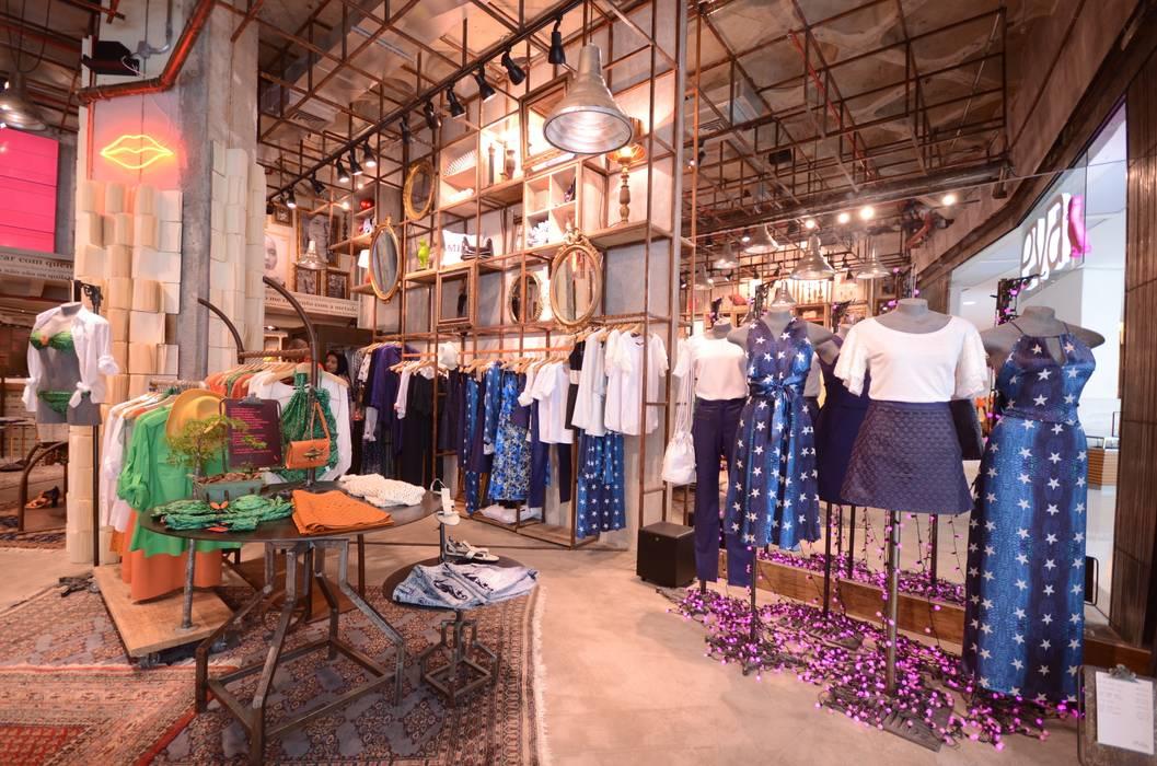 Eva: Lojas e imóveis comerciais  por Santa Irreverência Arquitetura Design e Construção,