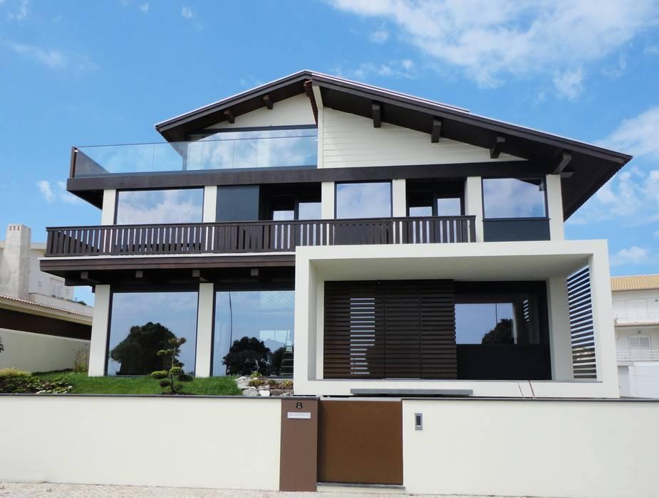 Alçado Principal: Casas  por GAAPE - ARQUITECTURA, PLANEAMENTO E ENGENHARIA, LDA,