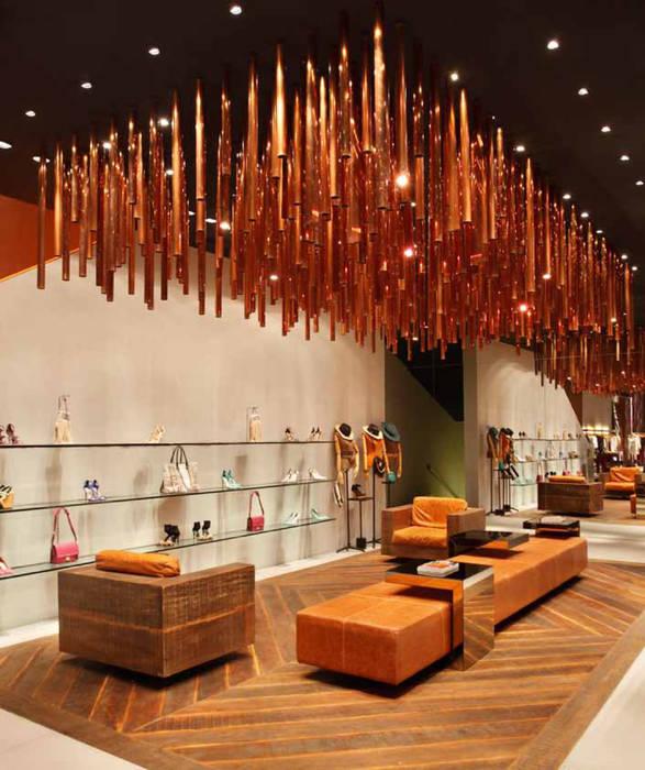 Animale: Lojas e imóveis comerciais  por Santa Irreverência Arquitetura Design e Construção,