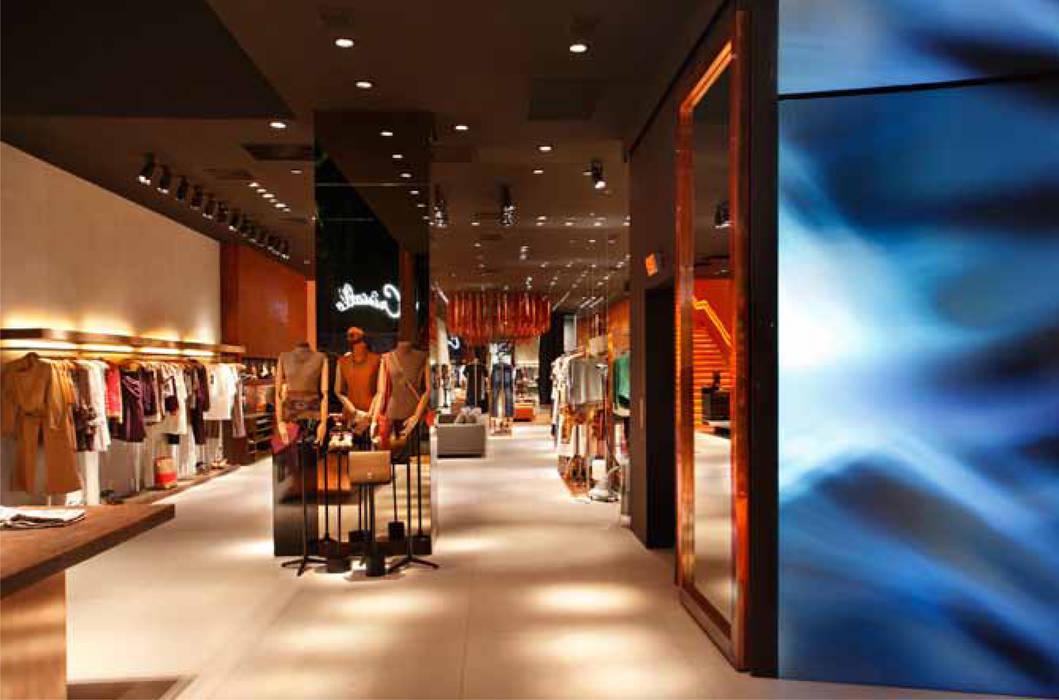 Animale: Lojas e imóveis comerciais  por Santa Irreverência Arquitetura Design e Construção
