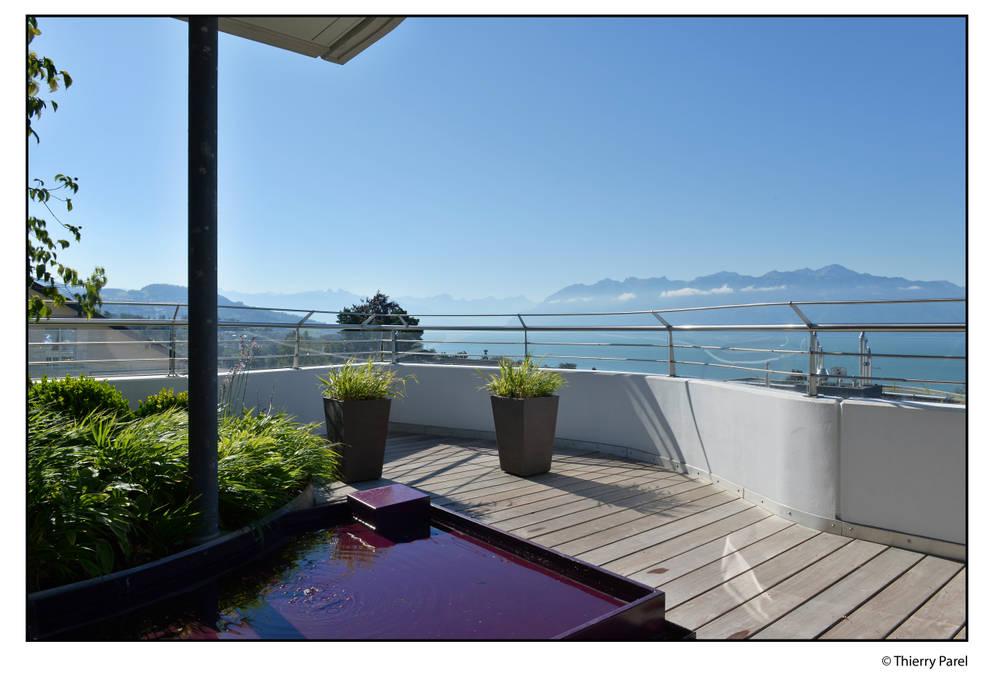 Terrasse urbaine: Terrasse de style  par Gilbert Henchoz Architectes Paysagistes Associés SA