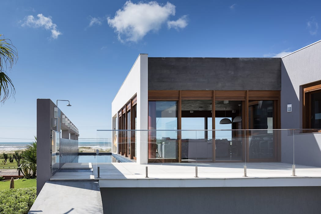 Casa Beira Mar - Seferin Arquitetura: Casas  por Seferin Arquitetura,Moderno