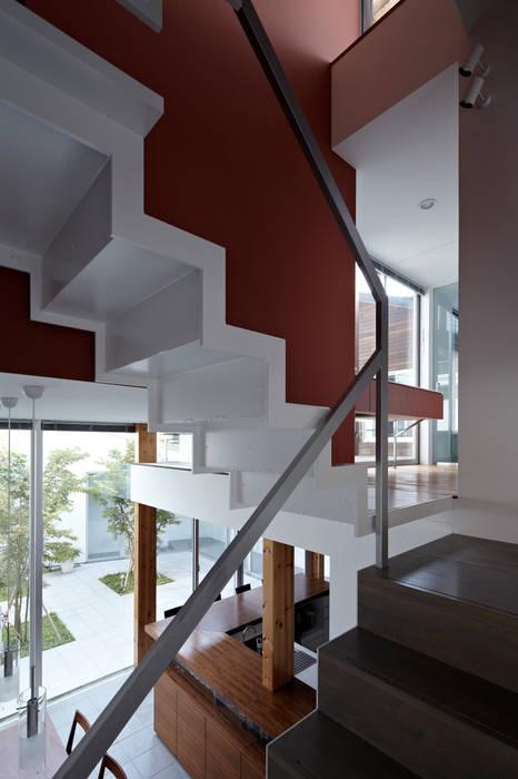 階段: 工藤宏仁建築設計事務所が手掛けた廊下 & 玄関です。