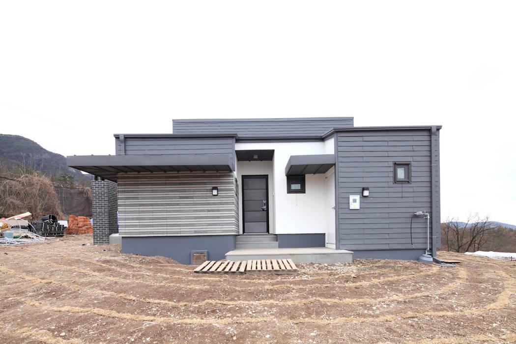 성벽안으로 들어가는 듯한 현관부 모던스타일 주택 by 주택설계전문 디자인그룹 홈스타일토토 모던
