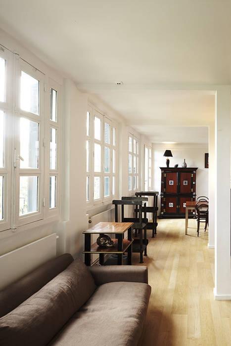 Salon: Salon de style  par Capucine de Cointet architecte