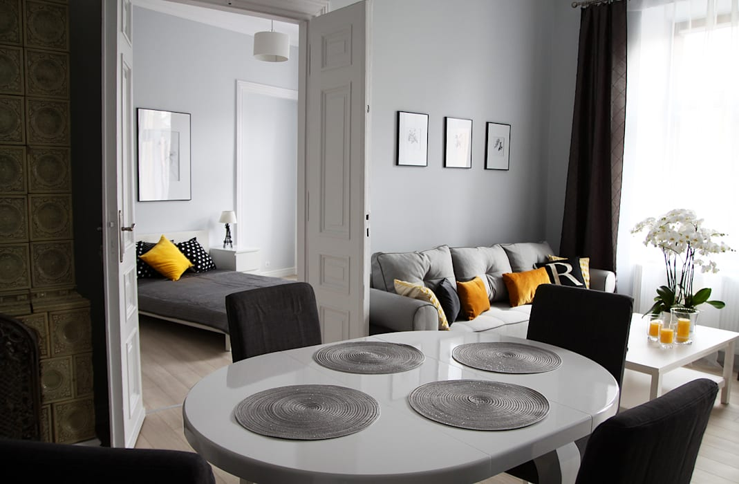 Salle à manger de style  par Grey shade interiors
