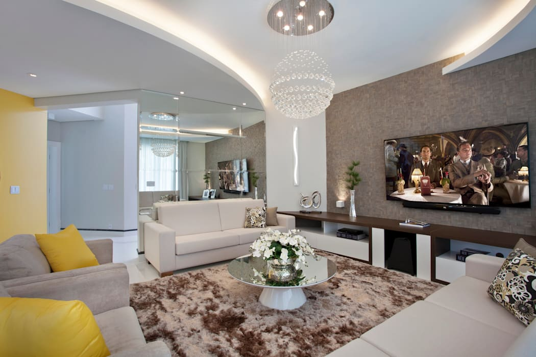 Salas de estar  por Designer de Interiores e Paisagista Iara Kílaris,