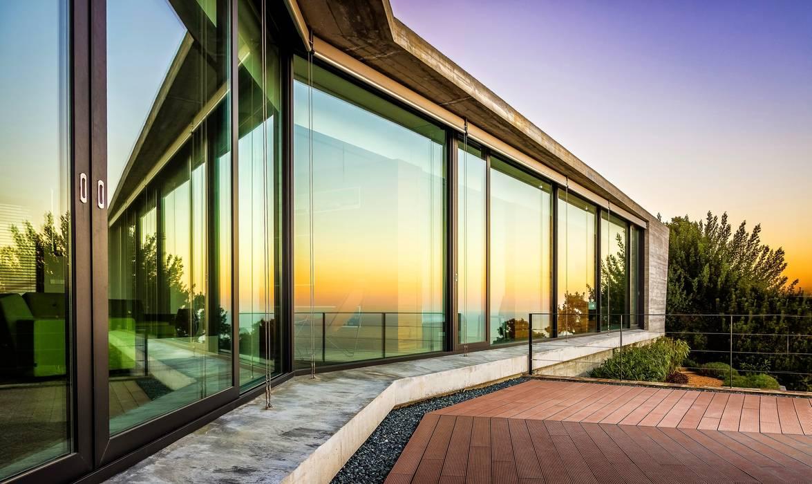 Belleza especular.: Ventanas de estilo  de VelezCarrascoArquitecto VCArq, Moderno