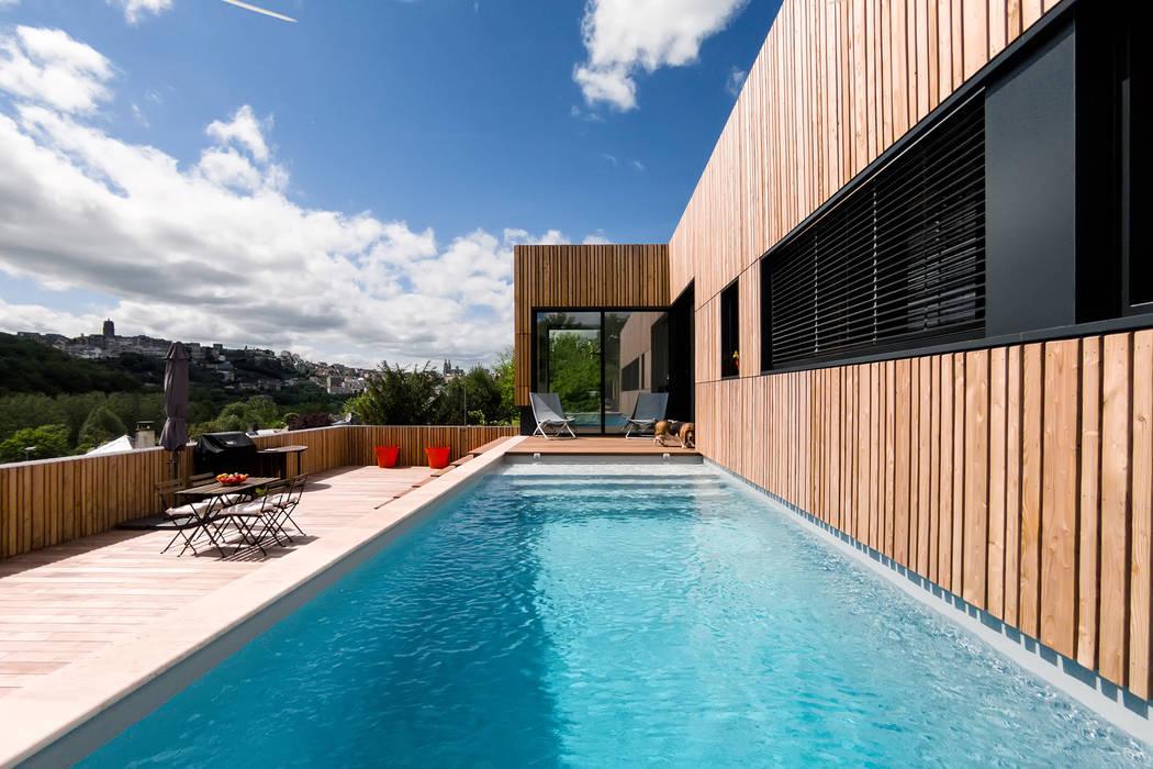 Modern Pool by Hugues TOURNIER Architecte Modern