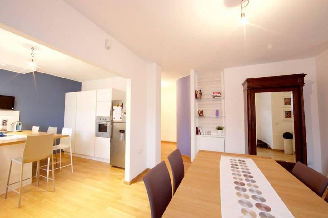 Zona pranzo: Sala da pranzo in stile in stile Moderno di Modularis Progettazione e Arredo