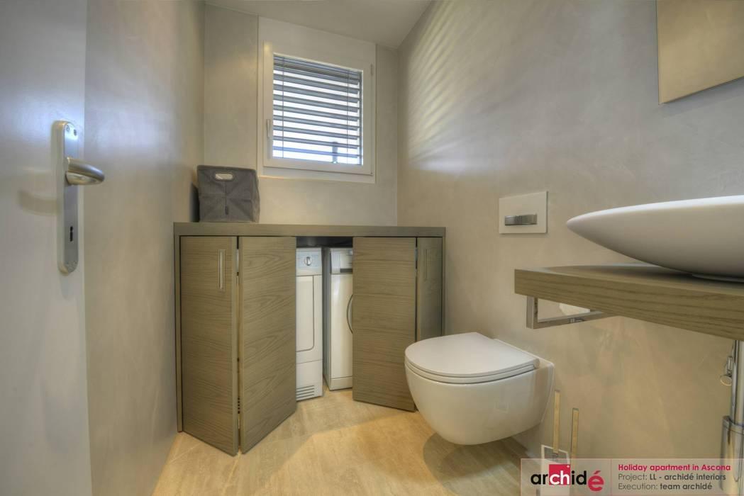 Ristrutturazione appartamento di vacanza Archidé SA interior design Bagno minimalista