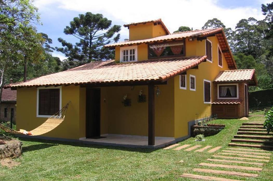 Casa de Campo em Araras: Casas  por Cadore Arquitetura