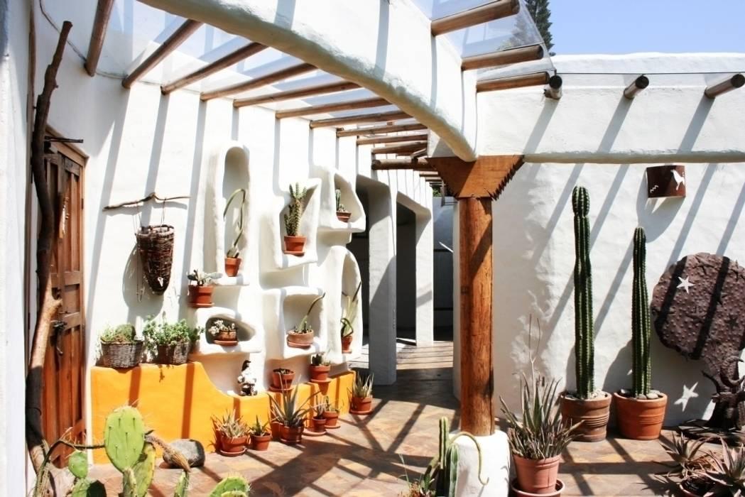 Pasillo Santa Fe : Casas de estilo rústico por Cenquizqui