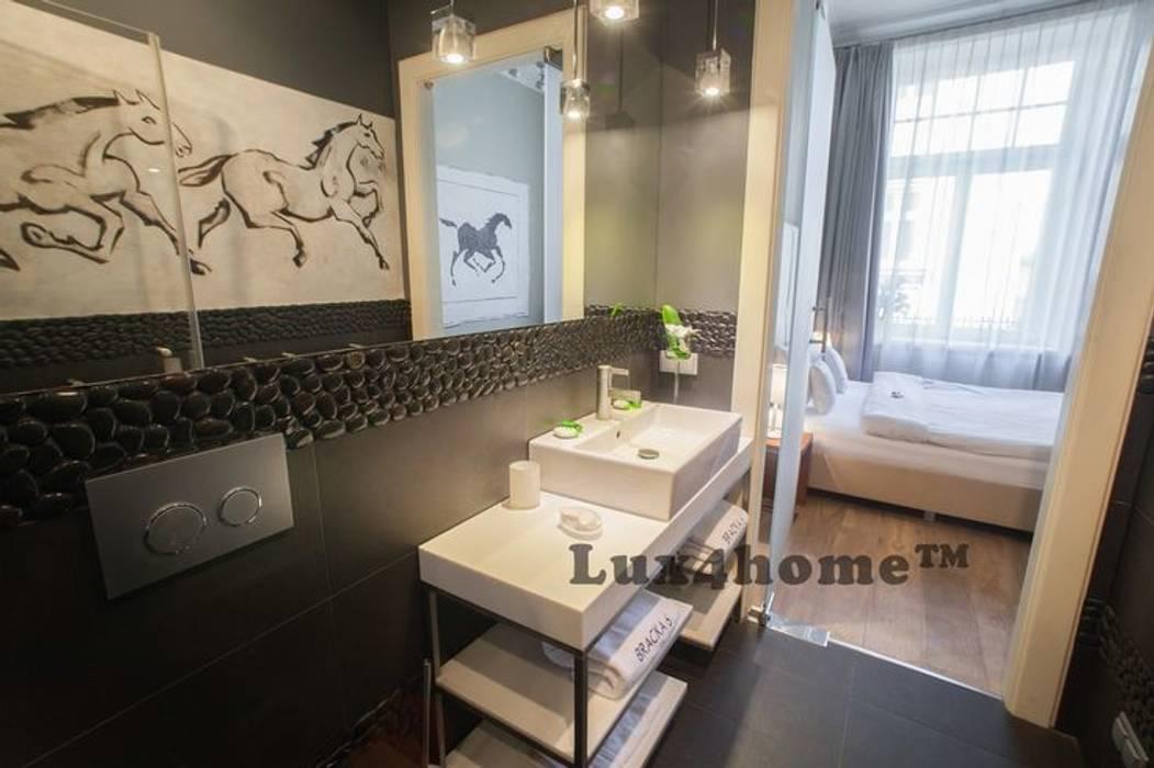 Ściany z kamienia - kamień dekoracyjny na ściany: styl , w kategorii Ściany zaprojektowany przez Lux4home™,