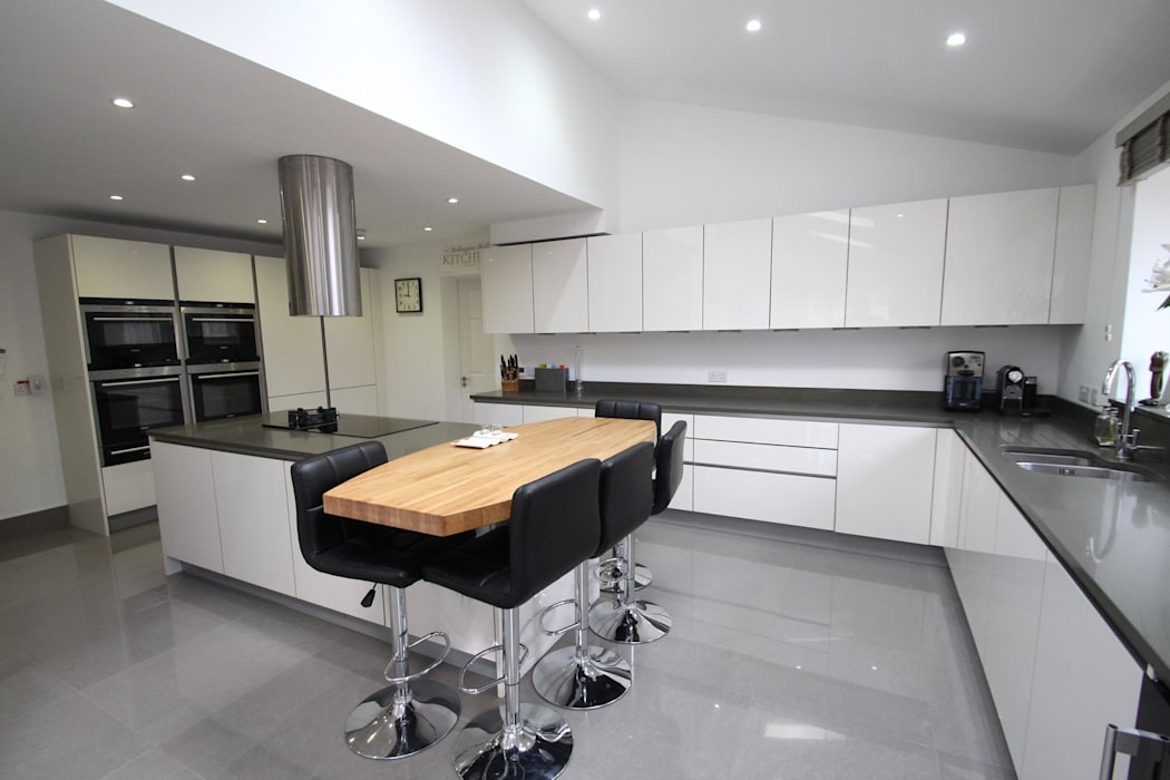 Modern white gloss English kitchen:  Kitchen by AD3 Design Limited