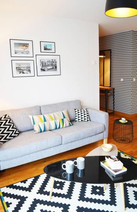Appartement 60m² - Villejuif: Salon de style  par Sandrine Carré