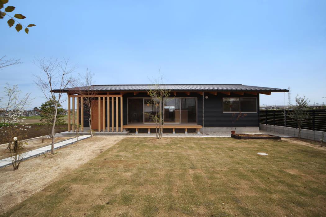 Casas de estilo asiático de 青木昌則建築研究所 Asiático